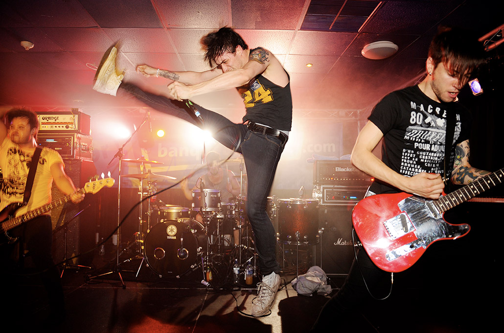 Gustav Wood of Young Guns with a high kick photographed by Marcus Maschwitz