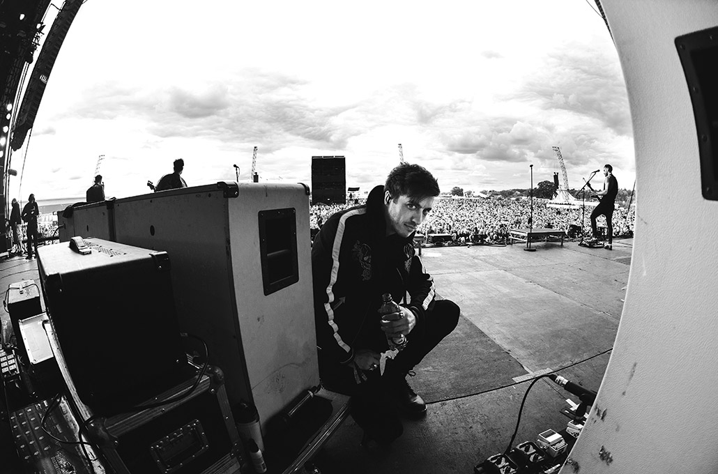 Gustav Wood of Young Guns on stage taking a moment at Reading Festival main stage photographed by Marcus Maschwitz