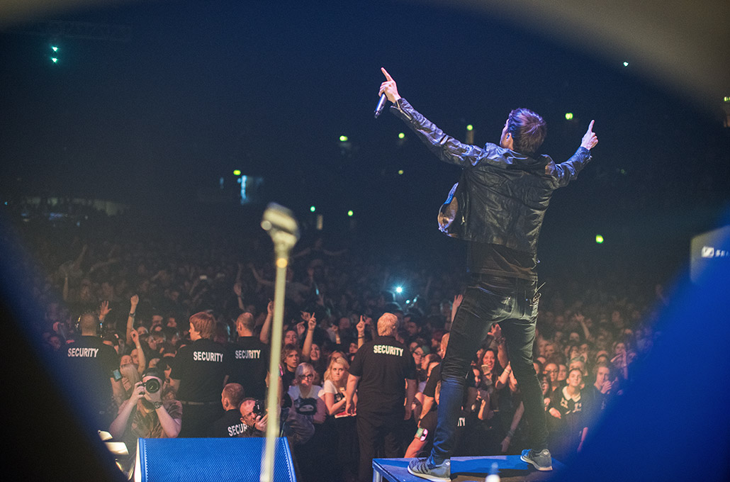 Gustav Wood of Young Guns on stage with the crowd at Wembley Arena photographed by Marcus Maschwitz
