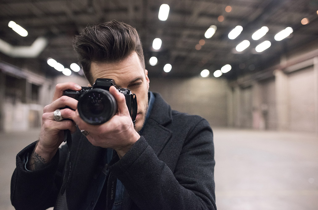 John Taylor of Young Guns with a camera on set photographed by Marcus Maschwitz