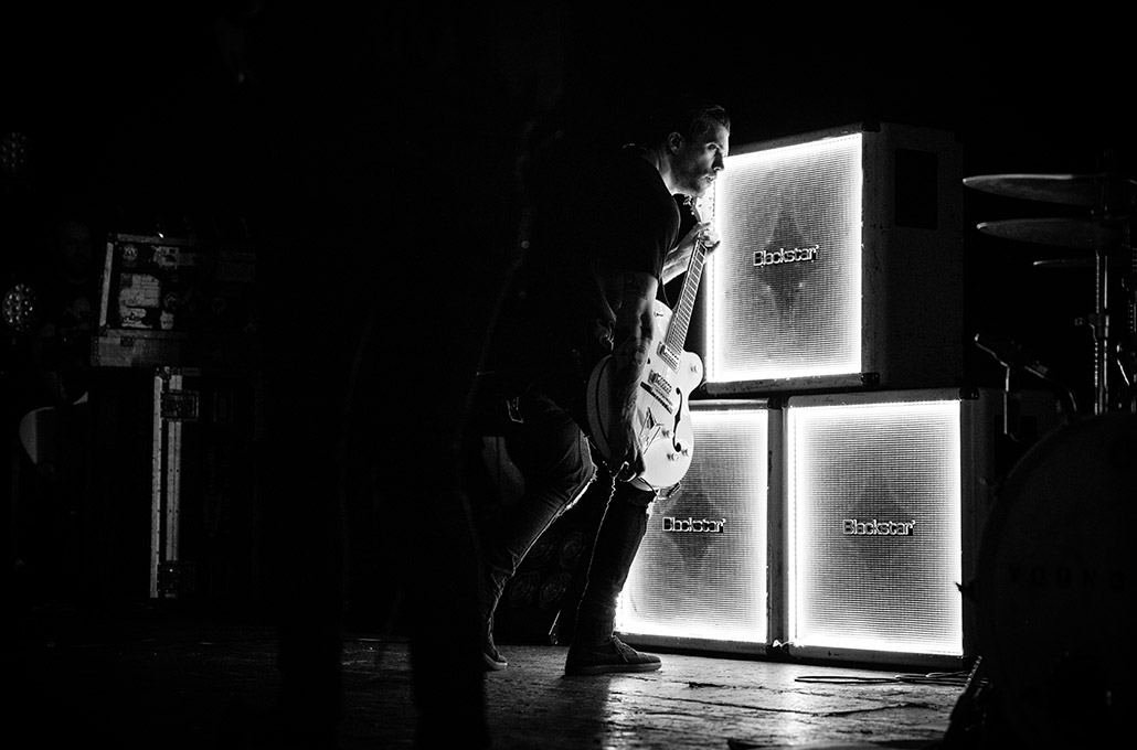 John Taylor of Young Guns getting feedback on stage at Brixton Academy photographed by Marcus Maschwitz