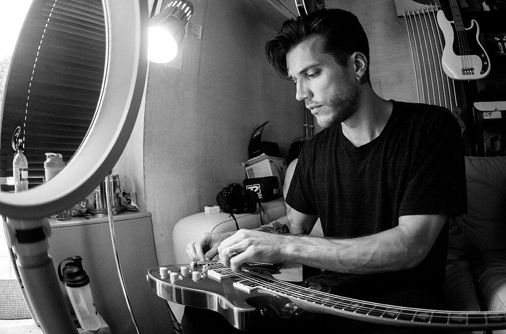 John Taylor of Young Guns restringing his guitar in studio photographed by Marcus Maschwitz